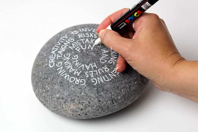 quote_on_stone_hand